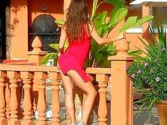 Guerlain takes off her shirt red dress outdoors