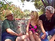 Blonde wife is fucked by two studs in front of her husband