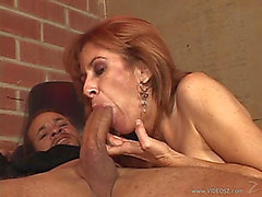 Redhead Cougar Gives Large Dark Weenie Orall-Service Then Rimmed In Interracial Sex