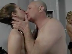 Two attractive women share an older guy !!!