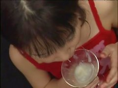 Japanese cutie jerks off her stud then swallows cum off a glass