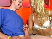 Ashley Fires does handjob for a younger guy