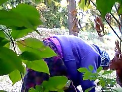 Granny is washing old pussy in woods near the road
