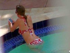 Slim sexy brunette in bikini gets filmed by voyeur