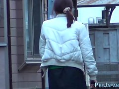 Japanese ho pees a puddle