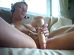 Attractive blonde milf masturbating her pussy that is sexy