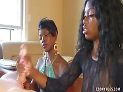 Two Ebonies Jerk Off A White Cock