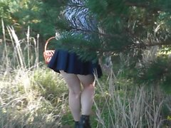 Naked in woods. Under skirt without panties