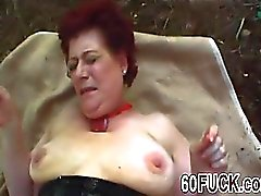 Redhead granny fucked hard in outdoor action