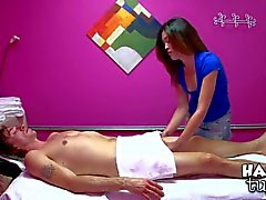 Aroused asian masseur gives a handjob