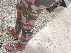 Big Ass Latina MILF standing in line with camo leggings
