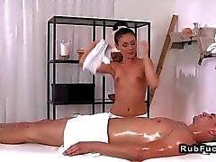 Hot masseuse giving handjob to customer