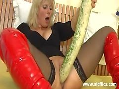 Amateur whore fucking a gigantic vegetable and monster dildo