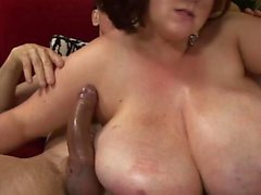 Cougar with big tits craves for a dick