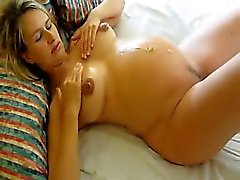 Pregnant wife fucks and gets cummed on abdomen
