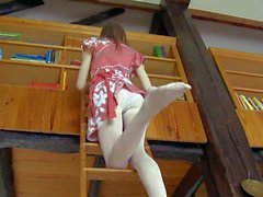 Young girl Gloria pulls off her pantyhose