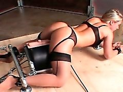 Blonde sex slave in chains fucked by a machine cums hard