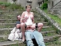 Mature matron in lingerie rides cock outside