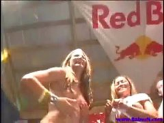 Lesbian chicks on the stage dancing while stripping