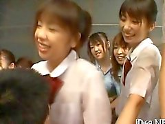 Asian schoolgirls swarm a hardened dick