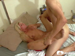 Blonde wife enjoys her son's friend's dick