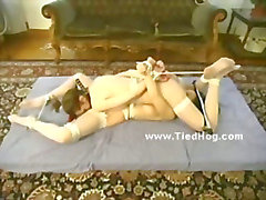 Two beautiful women are tied up gagged and flogged by two dominating men