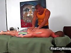 Masseur bathes a straighty in lotion