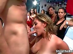 Male stripper gets a blowjob from a group of chicks