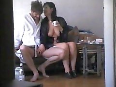 Busty brunette stroking dick on hid cam