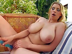 Heavy chested blonde Katrin masturbates in backyard