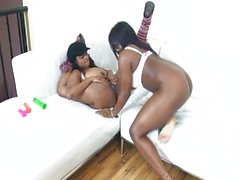 Ebony chicks licking and toying
