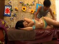 Nice Asian teen enjoys a sexy massage and fingering