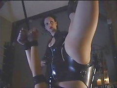 latex lesbian hanging upside down played by mistress