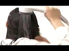 Asian maid washes her hair and gets dressed still rubbing h
