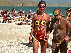 Girls with painted bodies in Russian nudist beach