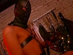 Master and slave masked in latex fuck