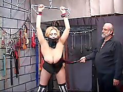 A beautiful, plump and voluptuous blonde gets her neck bound with her tits out