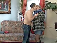 Young man fucks chubby granny on the couch