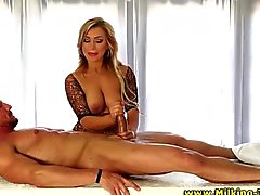Masseuse babe rubs hard cock