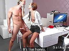 Female agent bangs blond model in office